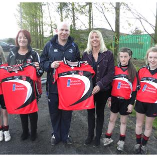 Mark Reilly Presents jerseys to Killygarry girls
