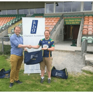 Denis Dolan  Presents gear bags to Ballinamore GFC