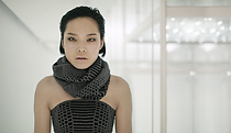 Woman wearing gray and black scarf and corset