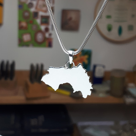 Pendant in the shape of the Republic of Guinea