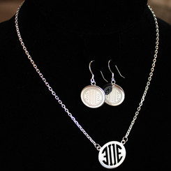 A client's logo transformed in to a cut out Pendant and engraved Earrings