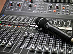 104008569-microphone-rests-on-an-audio-m