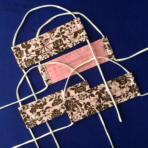 Locally Handmade Fabric Mask-Dark Chocolate Flowers on Pink Background