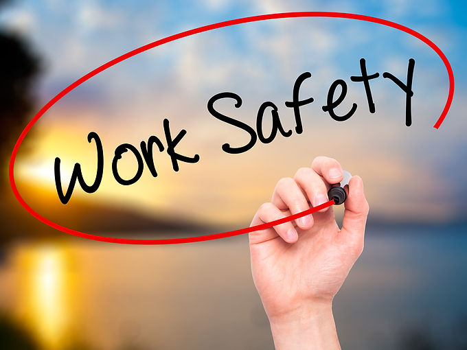 bigstock-man-hand-writing-work-safety-w-