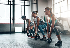 Women in Group HIIT Fitness Class