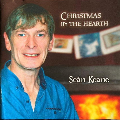Seán in front of the hearth in Carragh Cottage