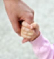 child holding hand.jpg