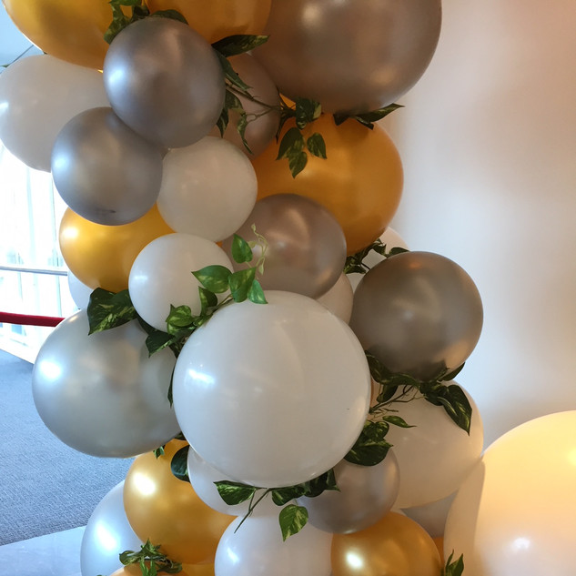 Gold, silver and white organic garland with foliage added.