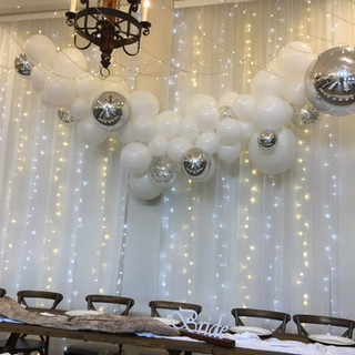 White with silver accents including silver confetti balloons