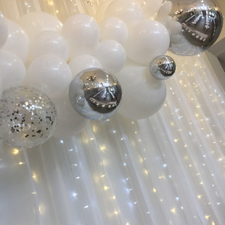 White with silver accents including confetti balloons