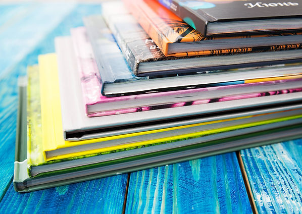 Color photo of large stack of paper books.  Photobook Album with Photos .jpg