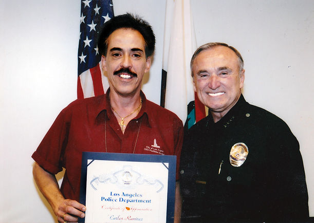 Carlos Rico and Chief of Police