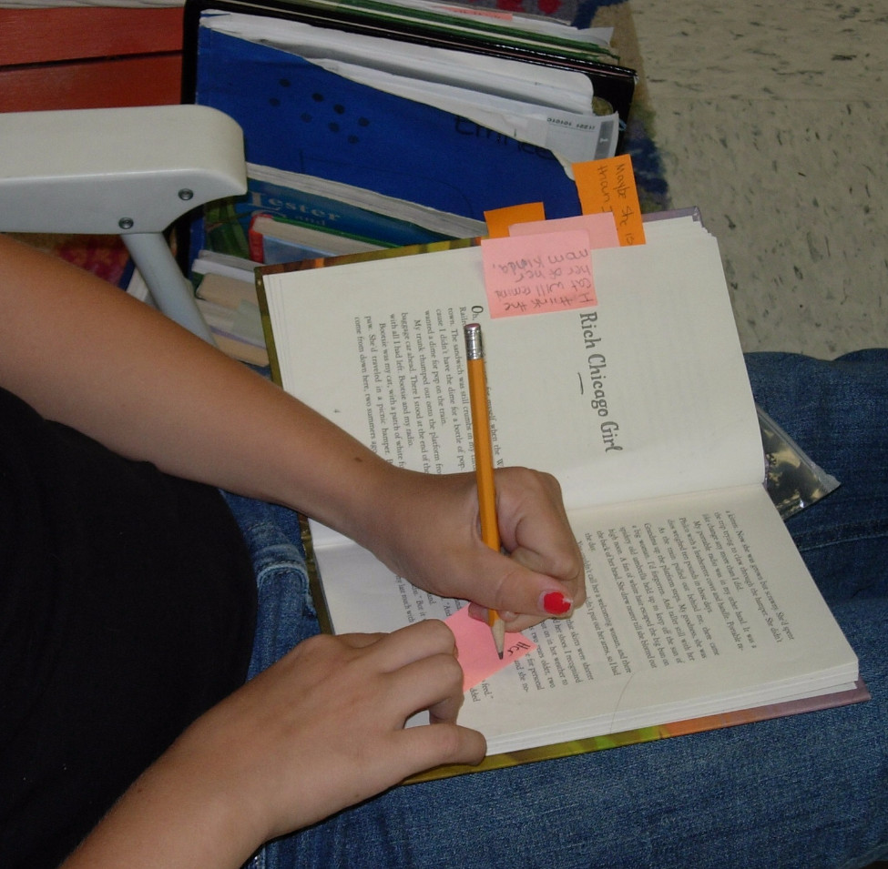 Student independent reading and thinking to jot notes
