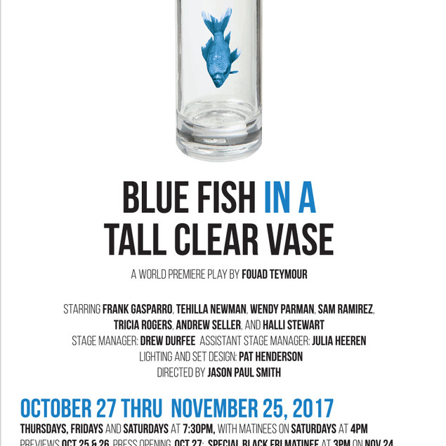 Blue Fish in a Tall Clear Vase