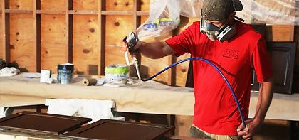 JTPD Guy Spraying Cabinets.jpg