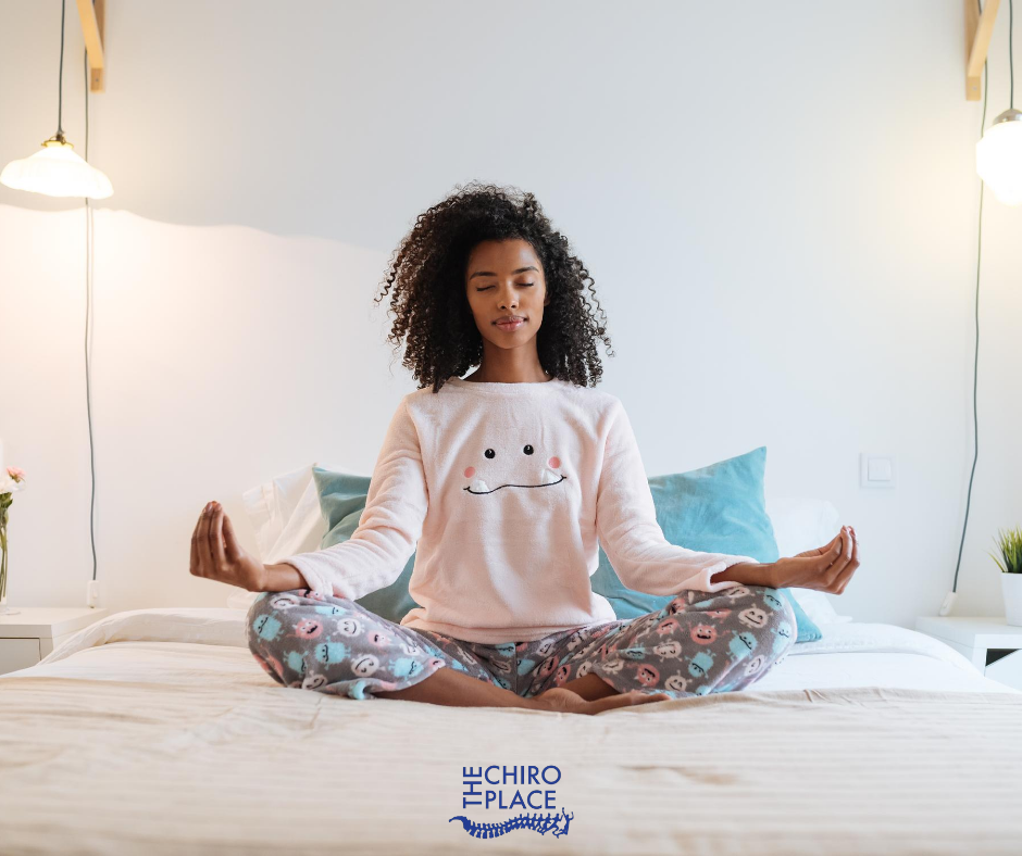 Girl meditating on the bed