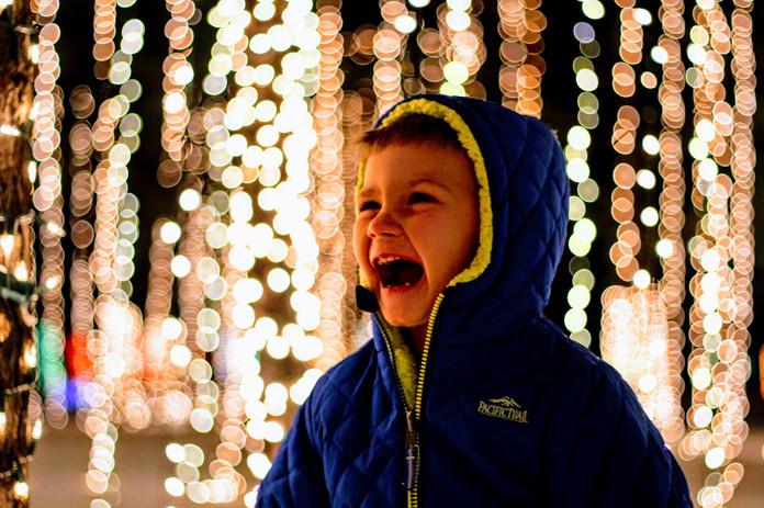 Boy gazing at white lights
