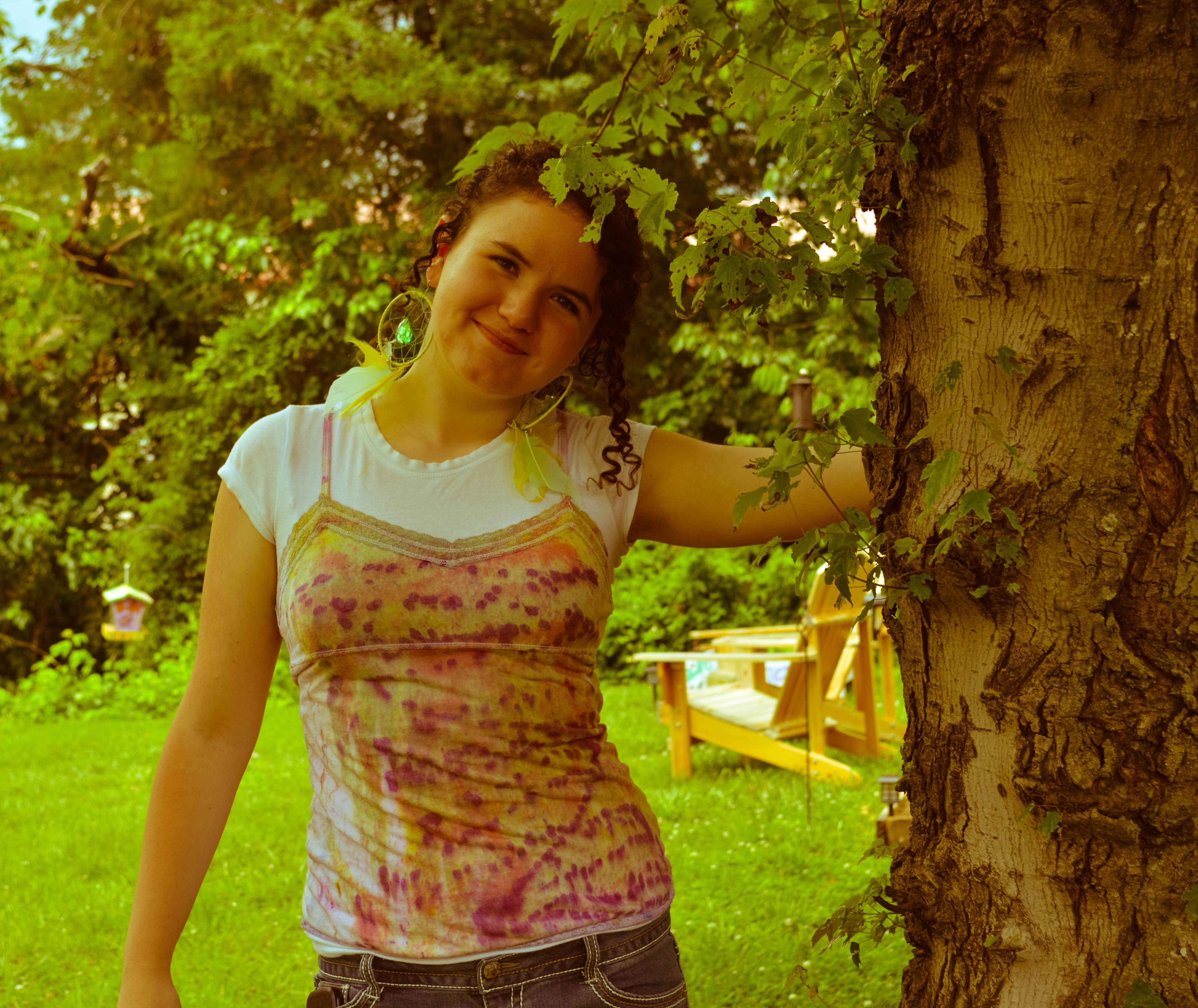 Lyssa modeling her tie dye by tree