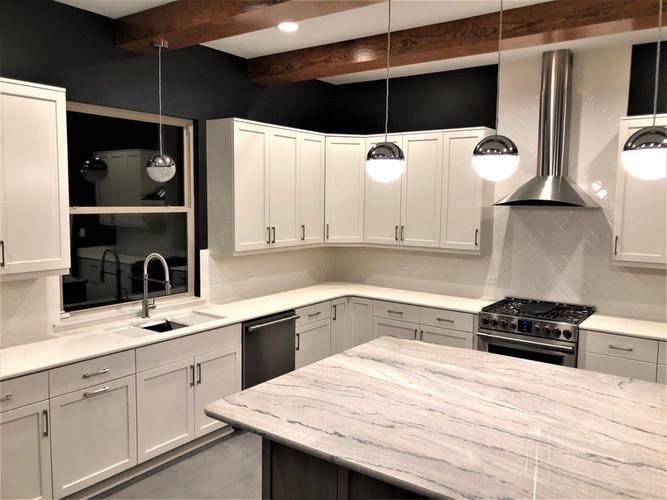 Quartzite Countertop White Cabinets.JPG