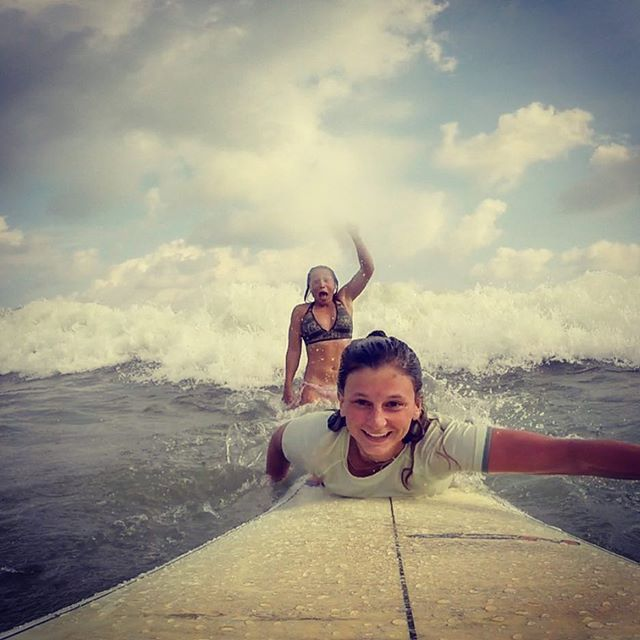 THIS IS HOW I FEEL WHEN SARAH CATCHES A WAVE!! By far the best picture we've taken thus far in Sri L