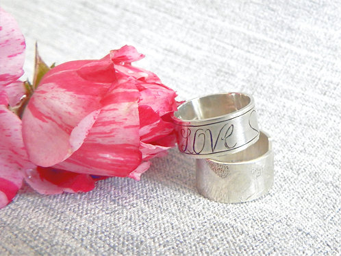 Hand engraved silver rings