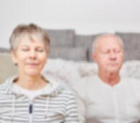 meditation-senior-woman-man-their-home-1