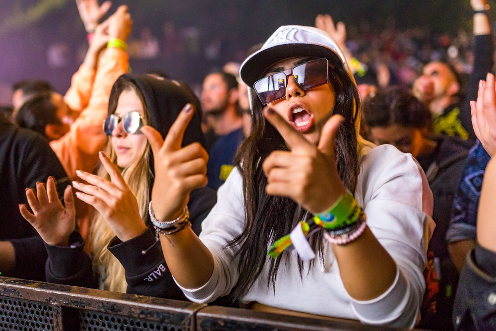 Girls in the crowd dancing to hardstyle