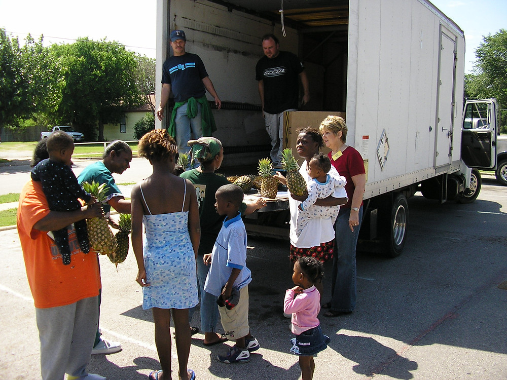 This is me, JoAnn, giving out food in the impoverished communities in Fort Worth, TX.