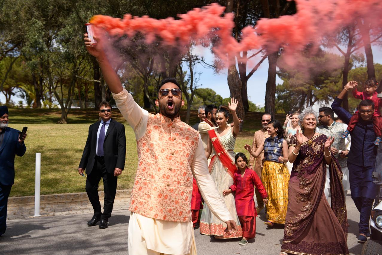 Hindu wedding baraat with smoke bombs