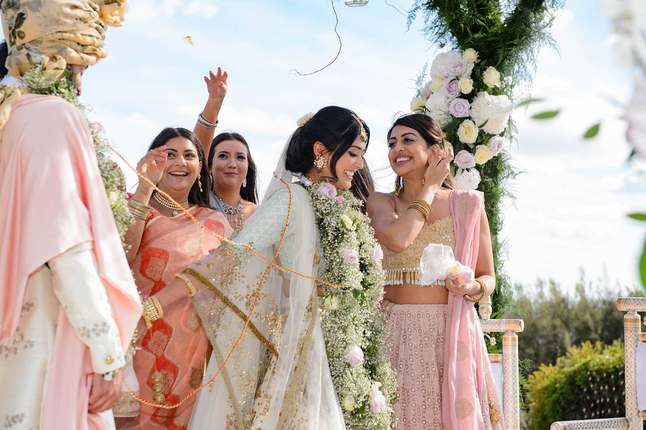Asian bride and groom at their Hindu wedding ceremony in the Algarve, Portugal at Pestana Alvor Praia