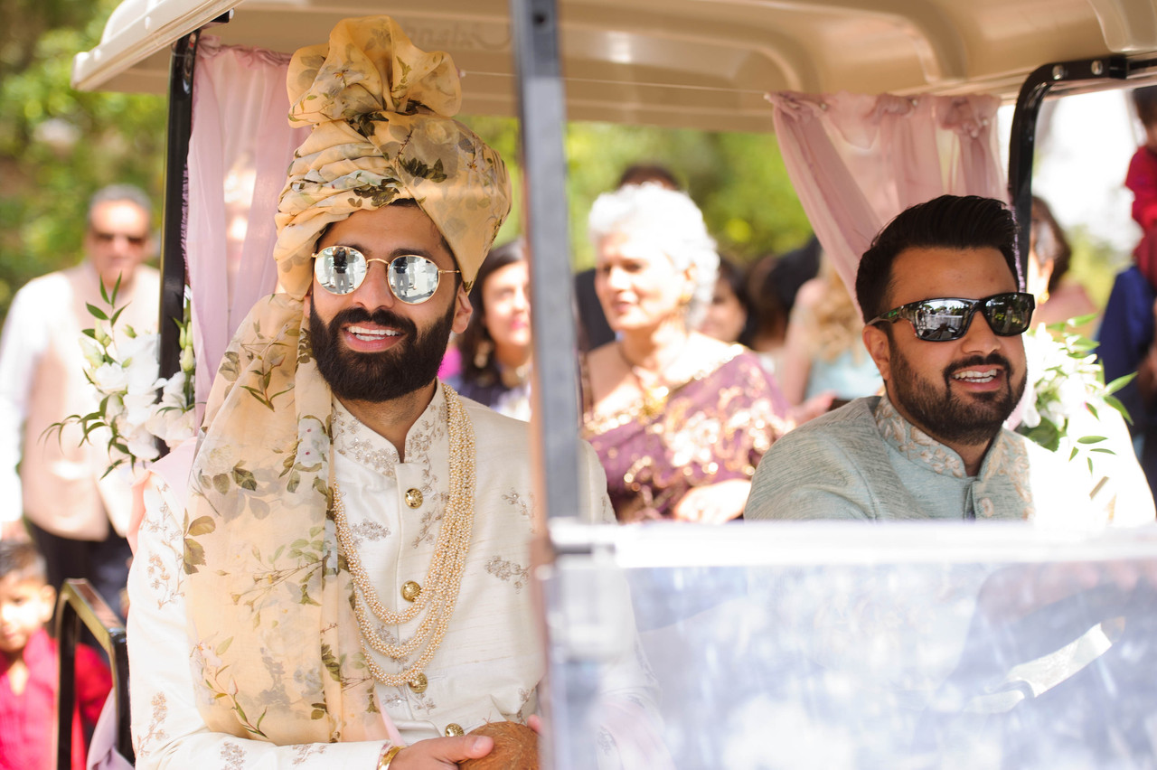 Hindu groom and best man making their entrance to the Hindu wedding ceremony