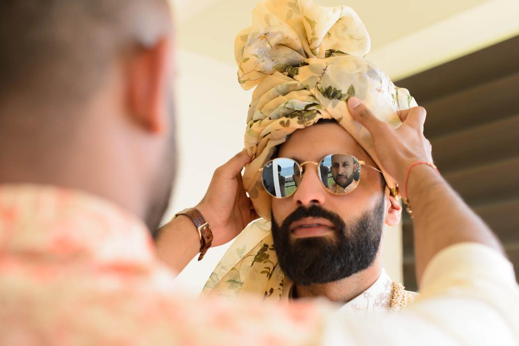 Asian groom getting ready ahead of his Hindu wedding