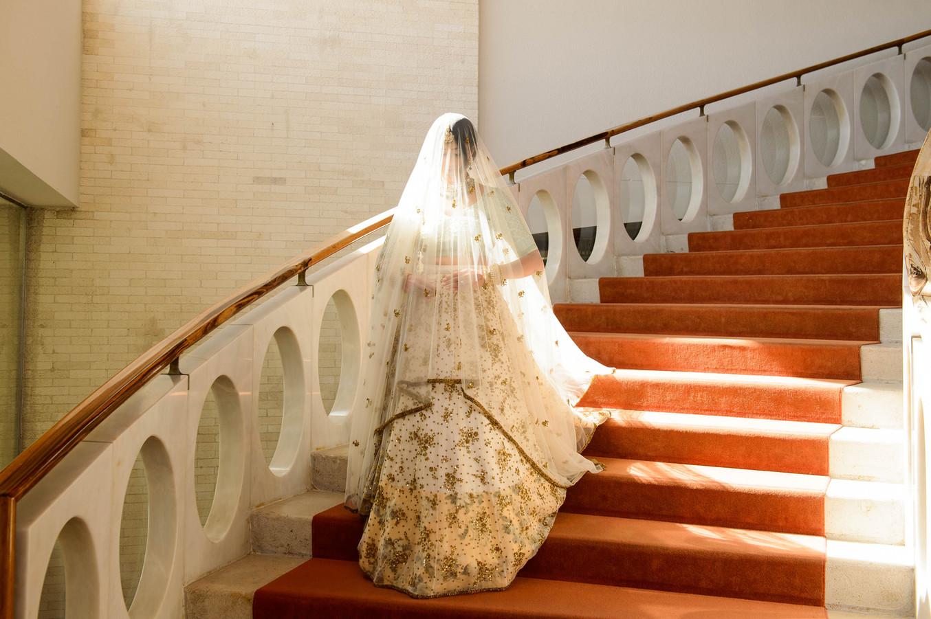 Asian bride making her entrance at her hindu wedding in Algarve, Portugal