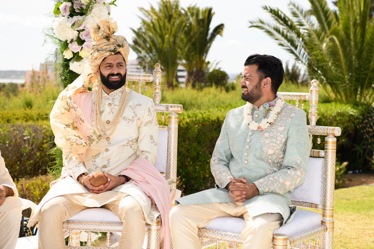 Asian groom and his best man at a Hindu wedding in Algarve, Portugal