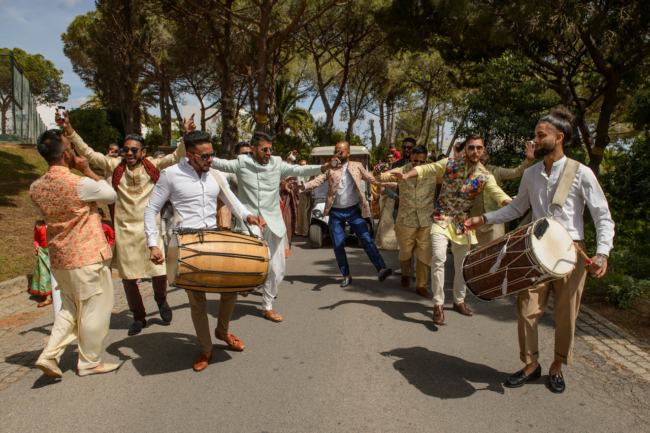 dhol players leading the baraat at a Hindu wedding in Algarve, Portugal