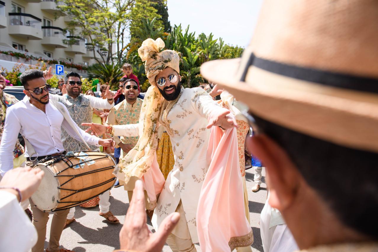 Asian groom at his baraat entrance