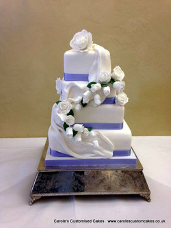roses and drapes wedding cake