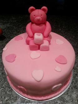 Pink teddy bear cake.