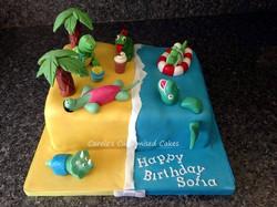 Dinosaurs at the beach cake