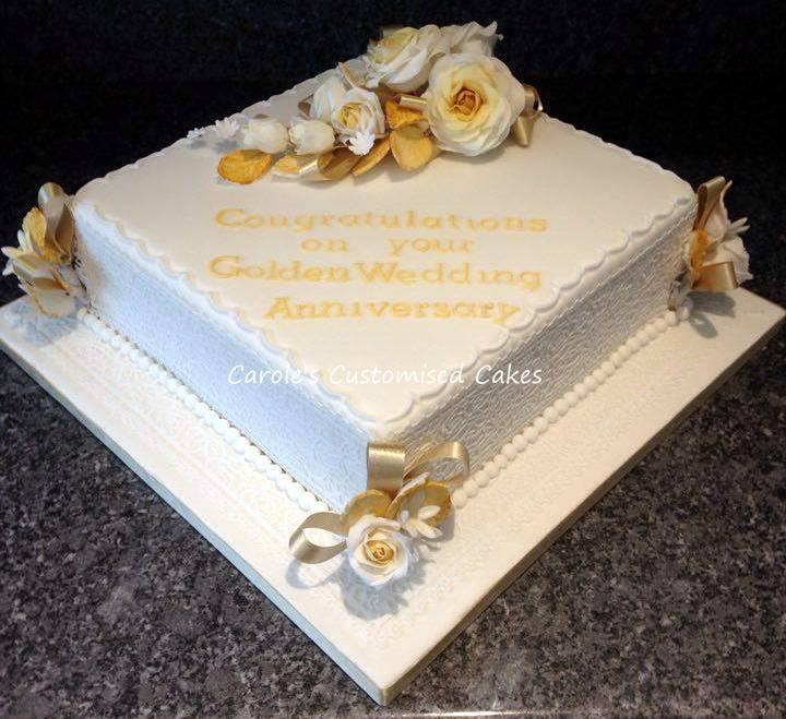 Golden anniversary cake with roses