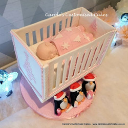 Baby in cot baby shower cake