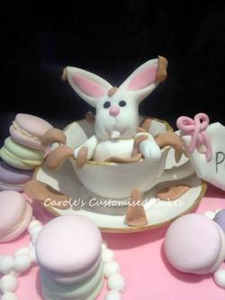 Rabbit in a tea cup cake topper