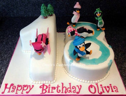 number 18 birthday cake with penguin