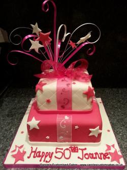 Pink and white 50th birthday cake