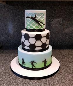 3 tier footbal themed cake