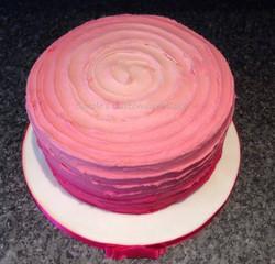 Pink buttercream rainbow cake