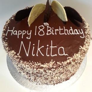 Chocolate ganache covered 18th birthday cake