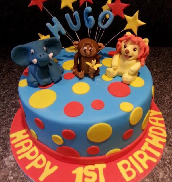 spots and starburst first birthday cake.