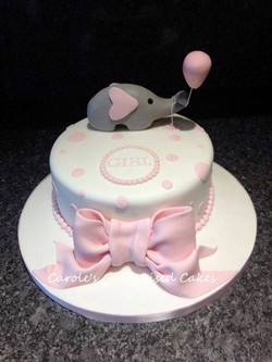Elephant with balloon cake and bow
