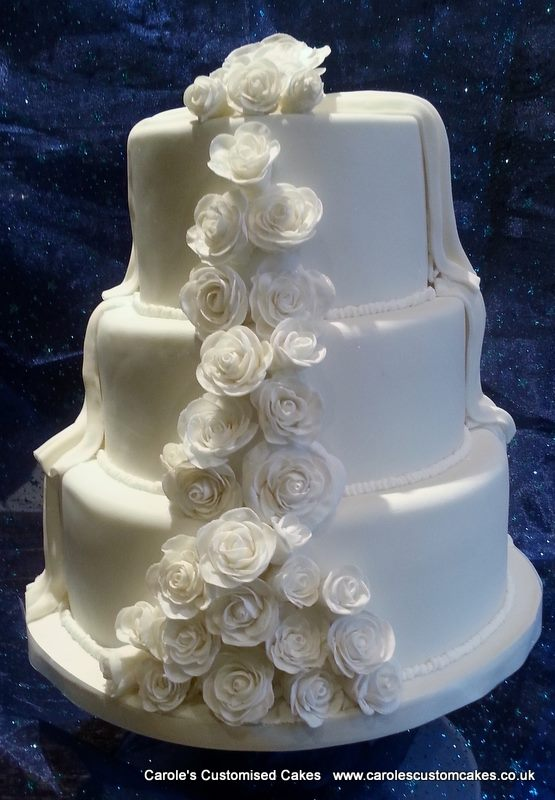 3 tier wedding cake with cascading roses.